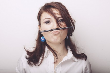 Female Blogger with Pencil on Mouth