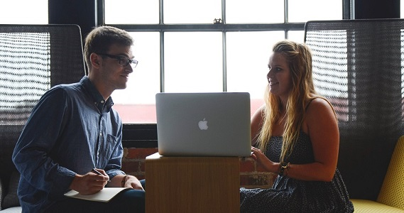Two Tech Professionals Meeting to Brainstorm Ideas Over Laptop